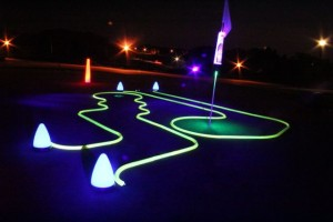 Two neon night golf putting hole