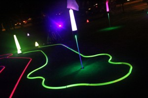 Neon black light mini golf holes